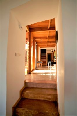 Casa Vejer: main house steps from living room to kitchen
