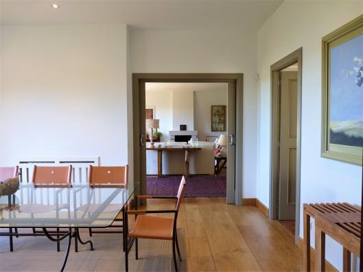 Casa Ruiseñada: living room and dining room